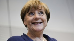 German Chancellor Angela Merkel smiles as she arrives for a special meeting of the Christian Democratic Union (CDU) party faction on the eve of a special session of the parliament Bundestag about negotiations with Greece for a new bailout in Berlin, Germany, Thursday, July 16, 2015. (AP Photo/Markus Schreiber)