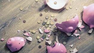 05 May 2015, Northamptonshire, England, UK --- Broken piggy bank and coins --- Image by © Dan Brownsword/Corbis